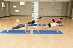 Latin Female practicing Yoga lotus position